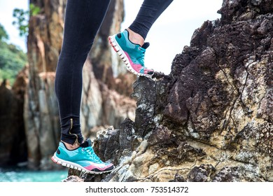 The girl in sportswear on the rocks , the concept of sports activity
