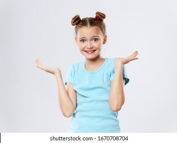 girl spreads her arms to the sides and smiles at the camer
