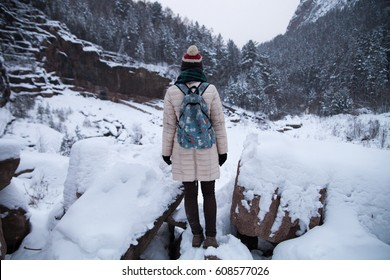 Girl stand back on outdoors