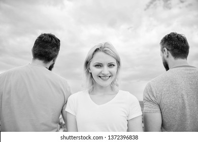 Girl stand in front two faceless men. Best traits of great boyfriend. She needs to pick better boyfriend. Everything you need to know about choosing right guy. Girl thinking whom she going ask dating.