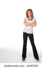 girl standing with arms crossed and pouting