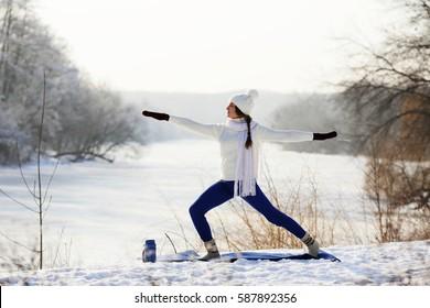 Girl standing in asana outdoors