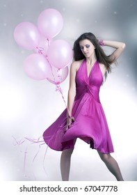 Girl standing with balloons