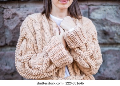 Girl standing in a handmade cardigan