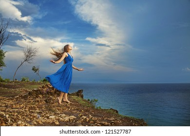 girl standing high against ocean, bali