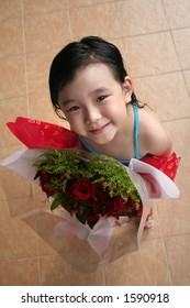 girl standing & holding bouquet of red roses