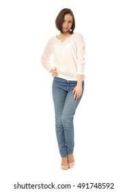 Girl standing in jeans in the studio isolated