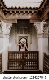 Girl standing in koran school Ben Youssef Madrasa in marrakesh marocco