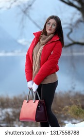 Girl standing near a lake