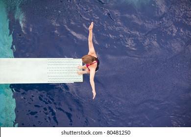 Girl standing on springboard