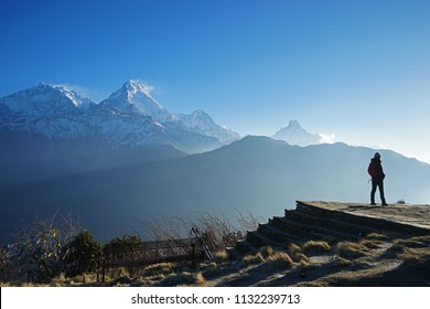 A Girl standing on top of Poon hill Himalayan mountain range-Ghorepani,Nepal