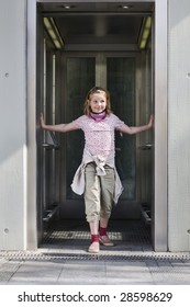 Girl standing in open elevator