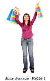 girl standing and smiling carrying shopping bags isolated over a white background
