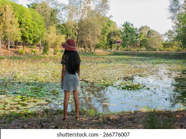 girl standing at the swamp