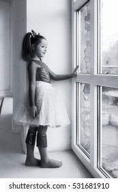 The girl standing at the window