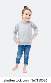 A girl stands on gray background. Grey sweater. Daily clothes demonstrate. other clothing for children and adults in my portfolio