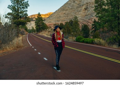 girl stands on the road in Zion National Park in southwestern Utah near the town of Springdale