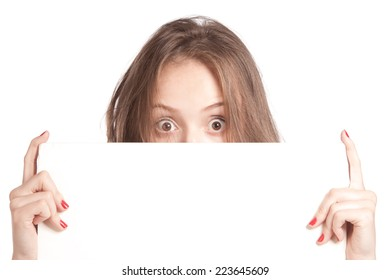 Girl stares and holding a blank, isolated
