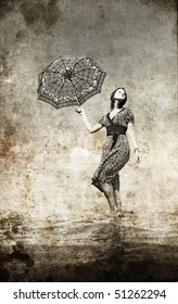 Girl stay outdoor in water with umbrella. Photo in old image style.