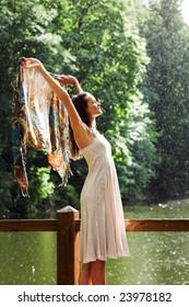 Girl stay under rain drops cover shawl