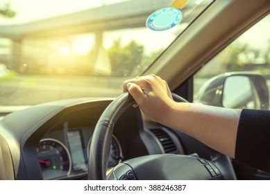 Girl steering wheel Sunny day on the road
