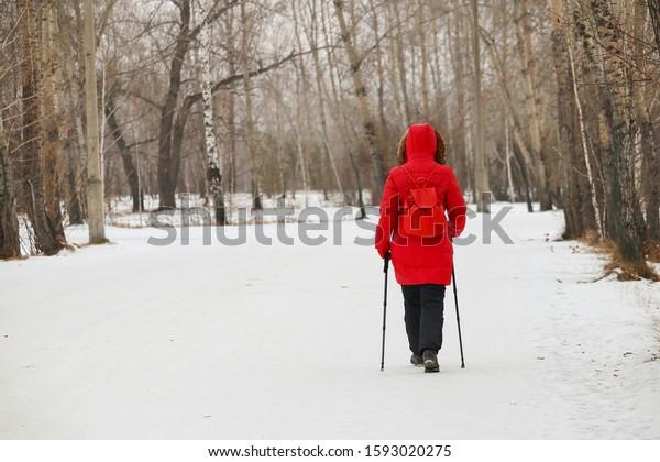 girl-sticks-nordic-walking-red-600w-1593