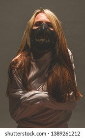 Girl in a straight jacket and bite mask