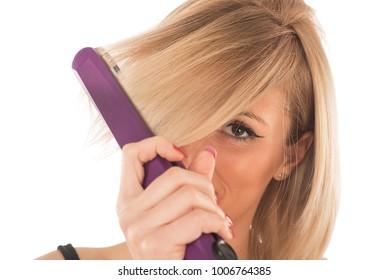 girl straightens the hair using a hair straightener