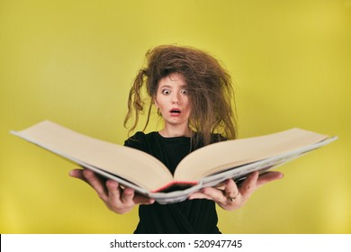 girl with a strange hair style and a big book