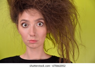 girl with a strange hair style on a green background