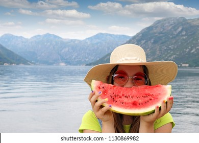 girl with straw hat sunglasses and watermelon on summer vacation