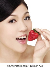 Girl with strawberry in hand isolated