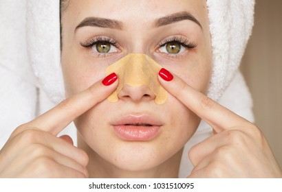 girl with a strip on the nose of acne
