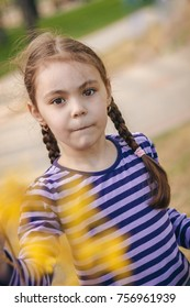 girl in a striped blouse with two pigtails