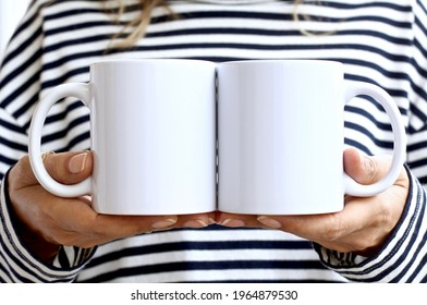 Girl in  striped sweatshirt holding white coffee mug. 2 white porcelain mug mock up. 11 oz mockups for front back design