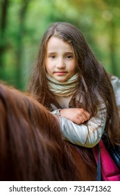 a girl strolls on her horse, active rest