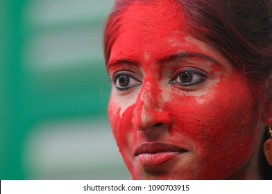A girl student all covered up with colored powder on the occasion of Vasanta Utsav at Jorasanko Thakurbari  on March 2 in 2015 in kolkata , India