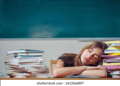 Girl student fell asleep over the books. Preparation for exams in school. Education in schools. Vitamin deficiencies for students. Young woman fell asleep while reading books at the table