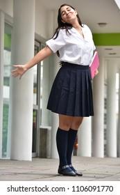 Girl Student And Freedom Wearing School Uniform
