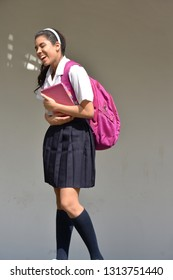 Girl Student Laughing Wearing Skirt With Notebook