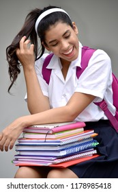 Girl Student With Long Hair Wearing School Uniform With Books