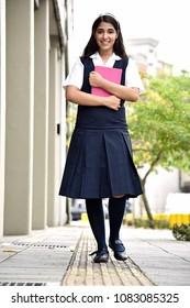 Girl Student On Sidewalk At School