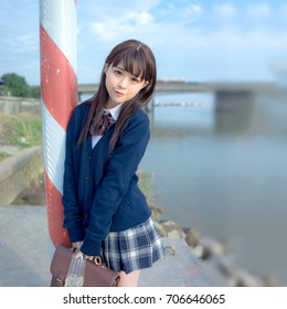 girl student in school uniform japanese style with blue sky