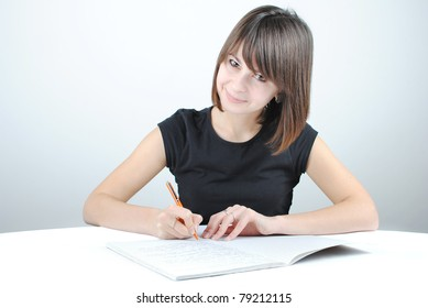 Girl student writes the exercise of the examinations