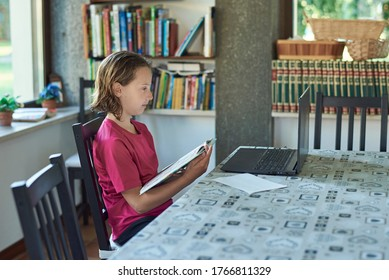 Girl studing online at home infront of the laptop
