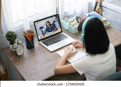 Girl studying homework online lesson at home, Social distance online education idea concept