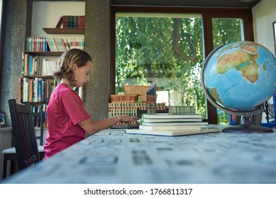 Girl studying infront of the laptop, home library