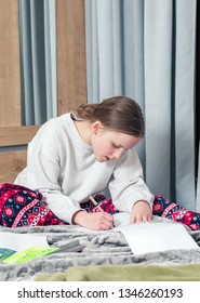 Girl studying and listening to music