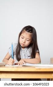 Girl studying and writing