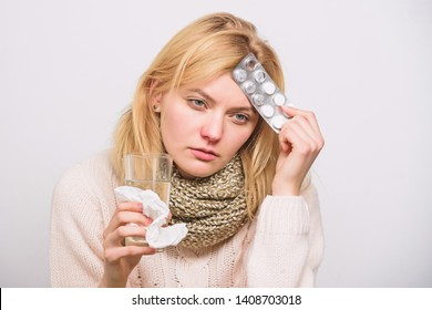 Girl suffer headache and take medicine. Headache and fever remedies. Woman tousled hair scarf hold tablets blister. Guidelines for treating fever. Take medications to reduce fever. Best fever reducer.